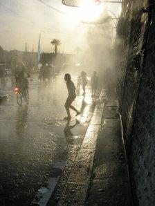 Water sprinklers along Paris Plage, La Rive Droit. June 2009.